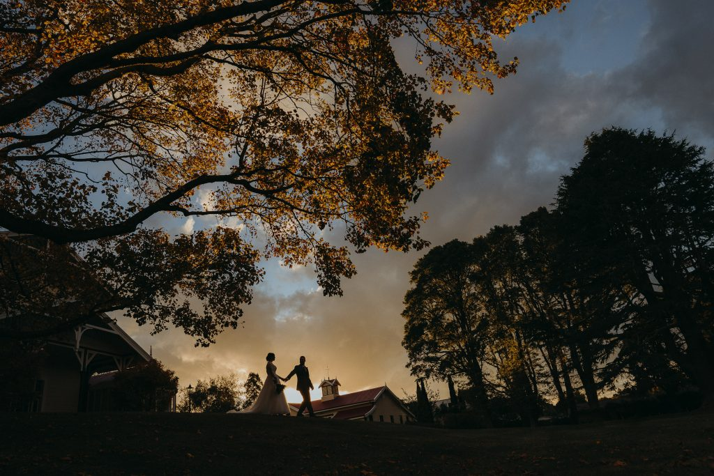 Golden hour wedding photo by wedding photographer Binh Trinh with Clare at Caccia Birch House