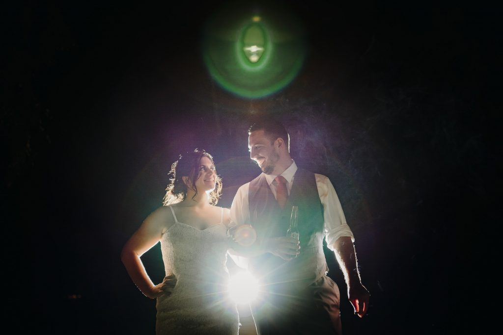 A create night time bride and groom wedding photo using flash by wellington wedding photographer Binh Trinh