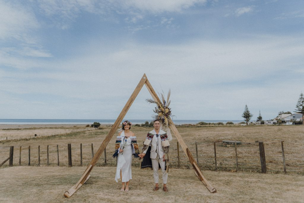 A contemporary wedding portrait image of bride and groom at their relaxing beach Hawke's Bay wedding