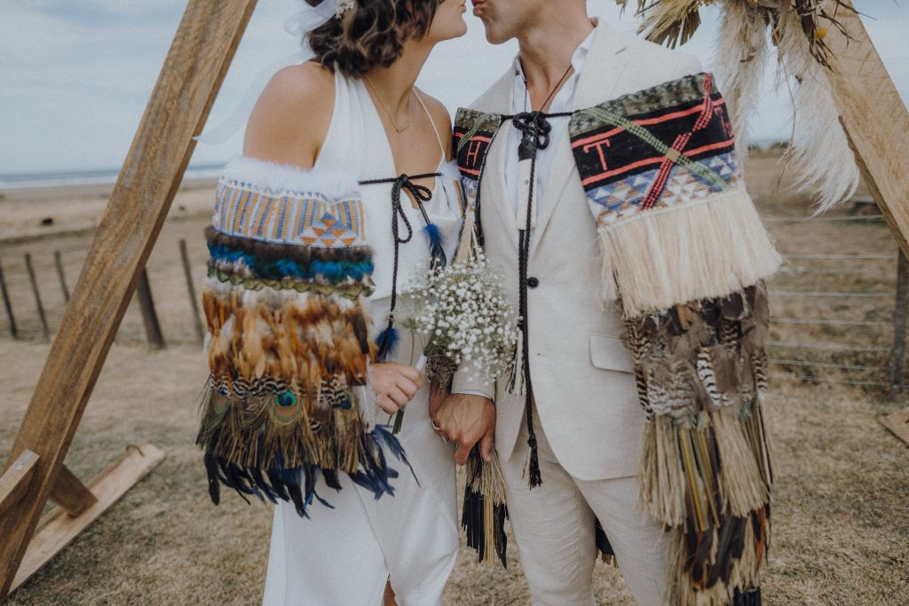 A stunning hawke's bay wedding photo of bridal and groom reflecting their Maori Culture with Binh Trinh.
