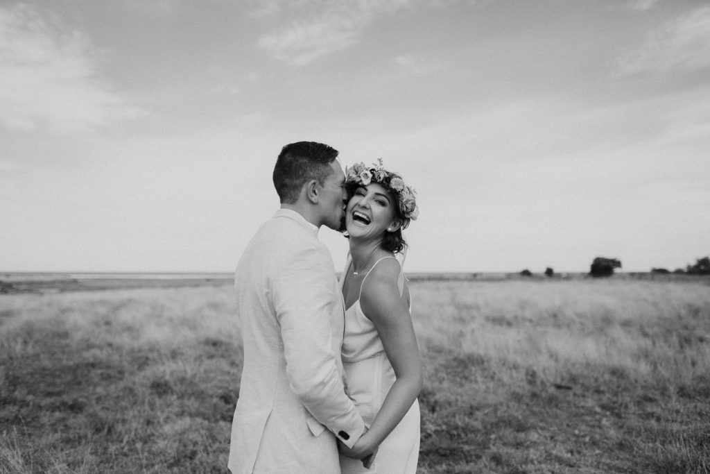 Hawkes Bay wedding photography Binh Trinh with this fun bride and groom portrait by the farm