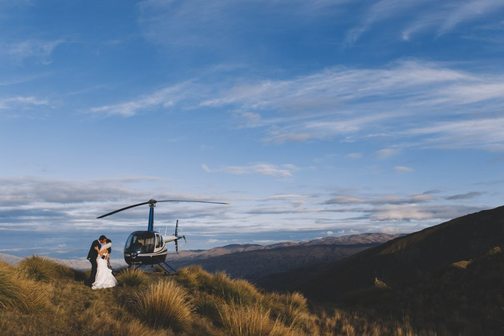 Bride and Groom kissing for their Queenstown Heli Wedding photo at Roy's Peak