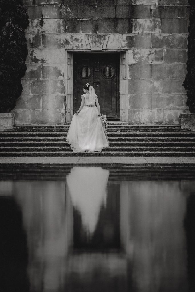 Auckland black and white wedding image of a bride by a pond in Mission Bay with Vicky and Binh Trinh