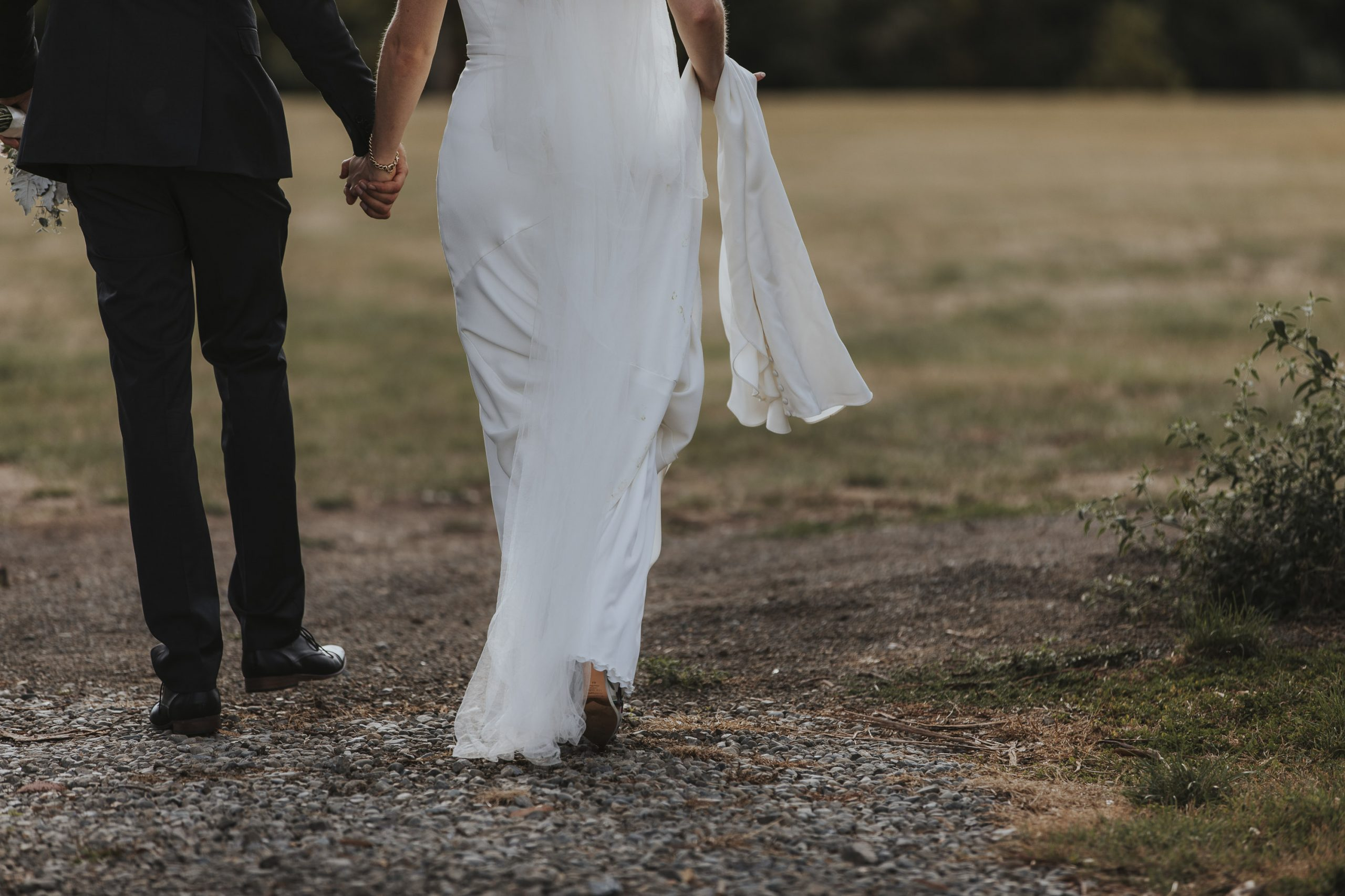 bride and groom walking away by wellington wedding photographer Binh Trinh
