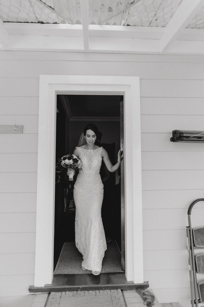 A classic black and white wedding bridal portrait at a door way at Orlando Country