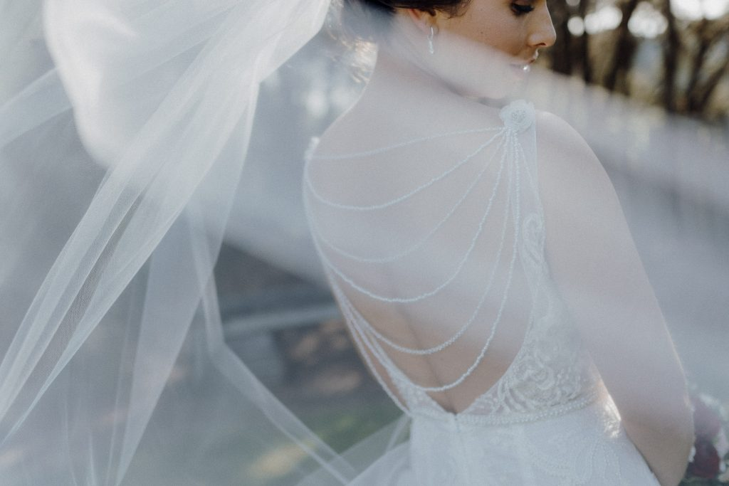 A closed up detail of back of a wedding dress with Josie at Makoura Lodge wedding venue
