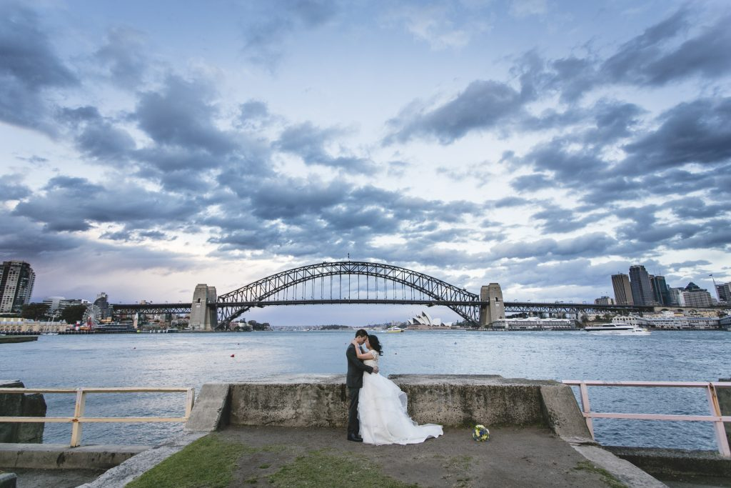 A stunning view of the Sydney Harbour Bridge in this bridal portrait by destination wedding photographer Binh Trinh