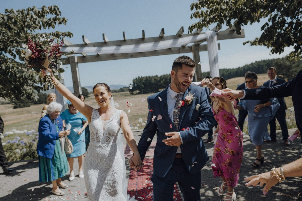 A bride and groom are walking down the aisle at Sudbury wedding venue in Wellington